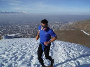Jared Campbell running with a respirator above the winter smog in Sal Lake City.